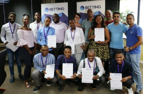 Bursary recipients, with seven from MUT,  and MUT and Hollywood Bets staff