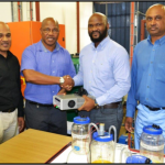 A soon to graduate student donates a power supply to the Department of Engineering