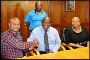 Welcome, left, shakes hands with Dr Malaza, while Nhlanhla and Dr Kwitshana look on