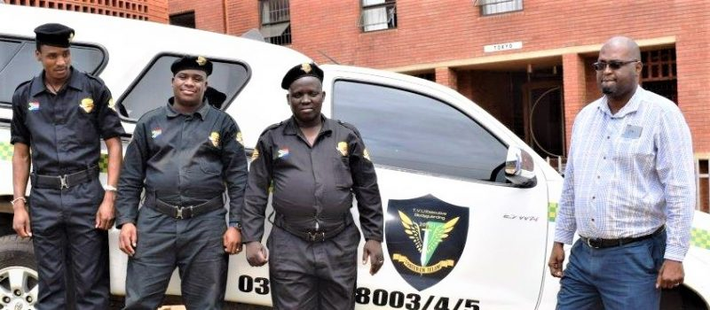 Sizwe, right, with some of the security guards