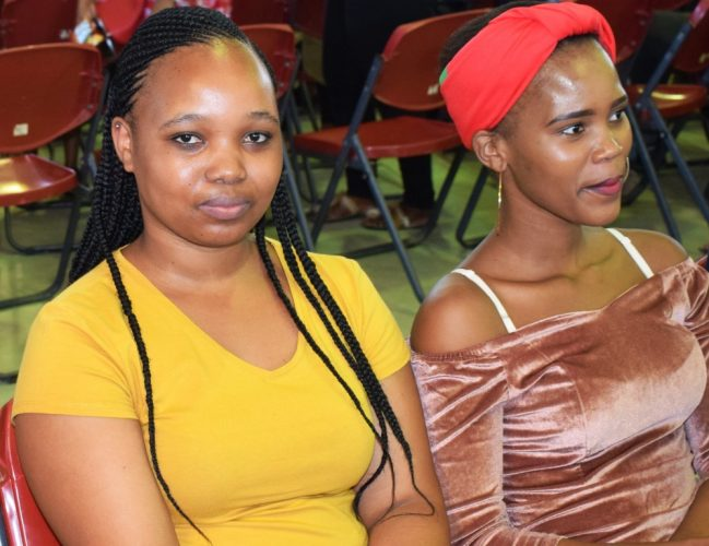 Mandisa, left, and another student, waiting to register