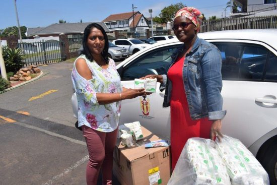 Zama, right, accepting the precious gift from Nellie