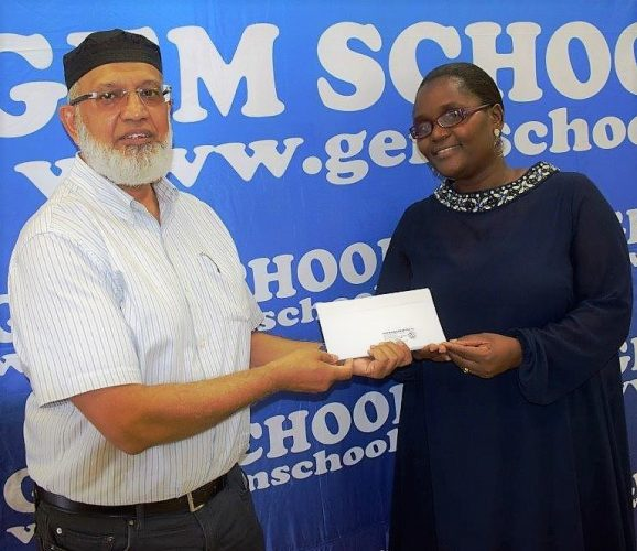Zama, right, receiving some gift vouchers from GEM's MD, Idris Pandor