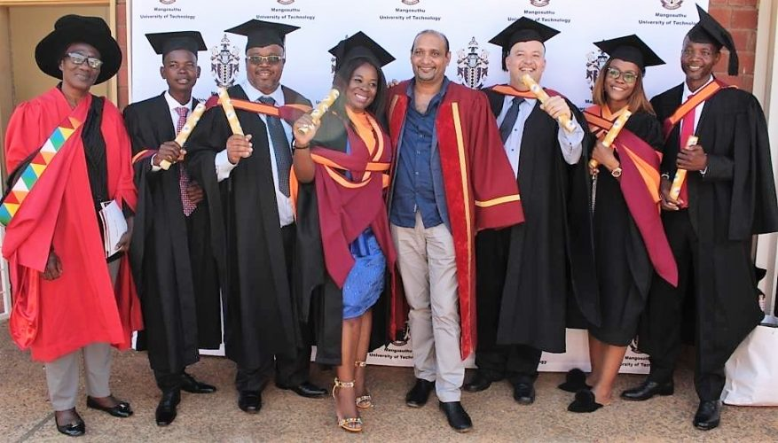 Professors in the Department of Nature Conservation, Georgina Arthur, left, and Roger Coopoosamy, fifth from left, with their Master's graduates at the graduation