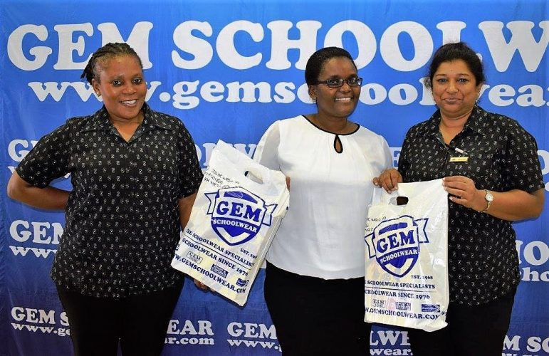 Thank you! Zama Sishi, middle, with GEM Schoolwear staff, Petronella Nzuza, left, and Christina Gopul